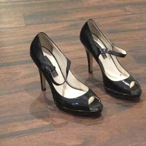 Black patent leather high heeled Mary Janes